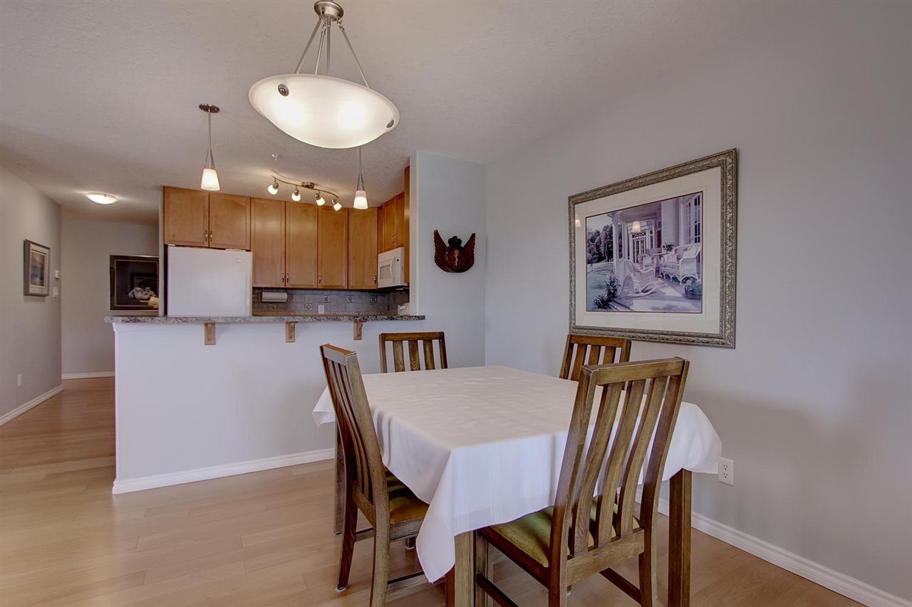 You can see the dining area opens to the kitchen for ease of setting the table. and staying connected.  but not seeing the preparation mess on the counters.