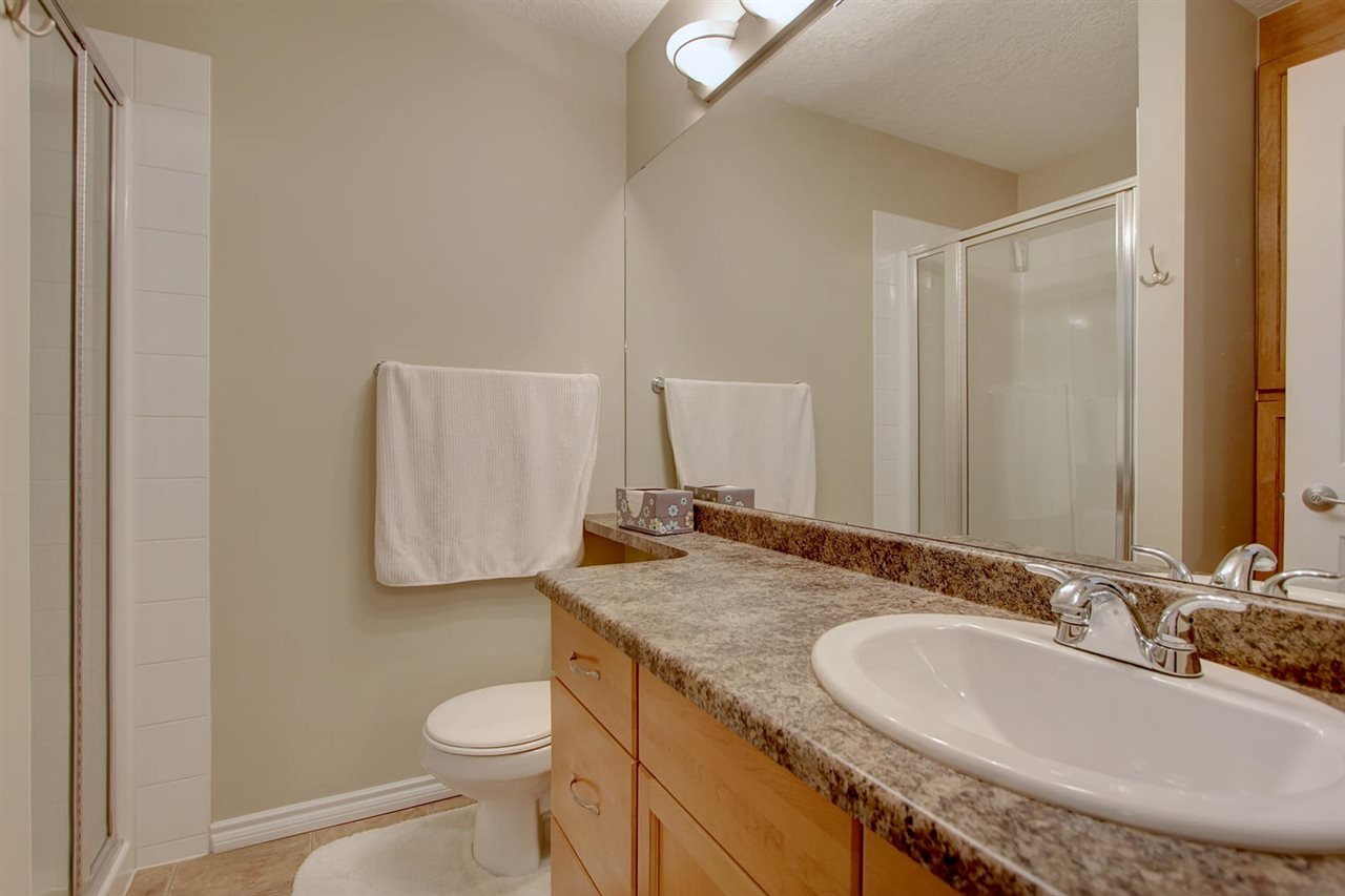 Inside the en suite bathroom you will find a large vanity with banjo counter tops. The shower is spacious and there is extensive storage behind the door with full doors.