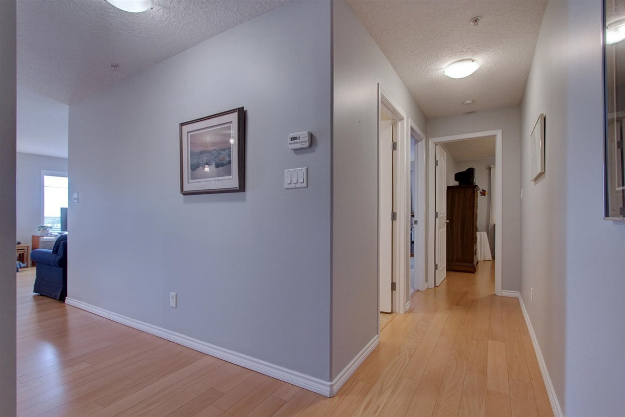 The hallways also boast engineered hardwood flooring as per the specs the condo requires for sound reduction between floors.