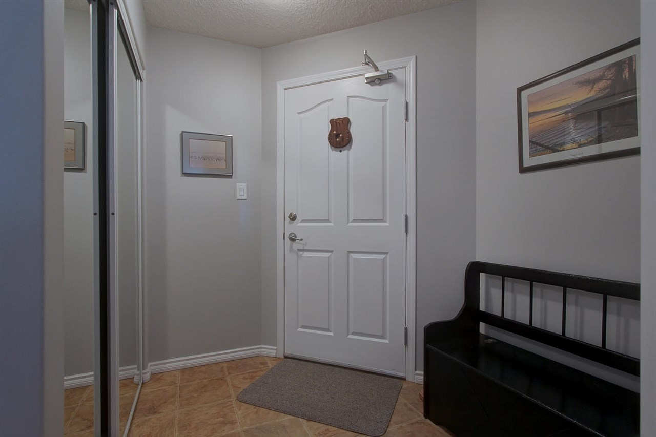 The entrance hallway to the unit is very much like walking into a bungalow home. Lots of space for a bench or chair and a large area with a large closet.