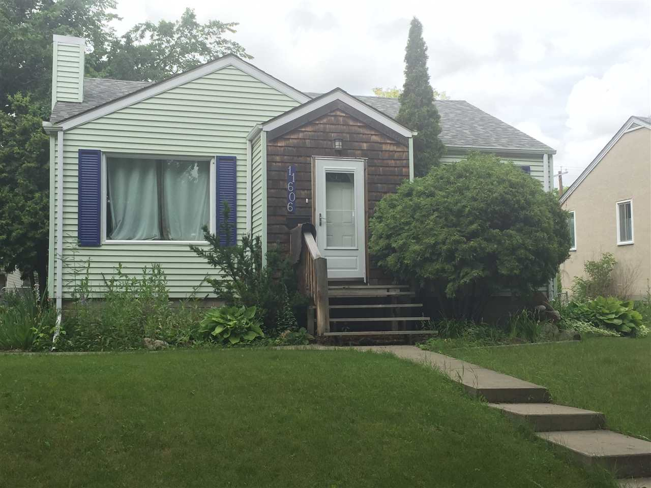 Fantastic opportunity to own a lovely home on a picturesque elm lined street in Inglewood! This cute and cozy bungalow offers 2 spacious bedrooms on the main level as well as a bright living room with coved ceiling and birch hardwood floors, updated 4 pc bathroom with tile floors and a cheery kitchen with open shelving. Basement includes a family room, bedroom and lots of storage space. Gorgeous, large west facing back yard offers two decks as well as oversized, recently built 26x26 double garage. Newer furnace and roof. Close to shopping, schools, and downtown. Currently rented for $1,500 per month, this home is a fantastic investment and/or development opportunity!