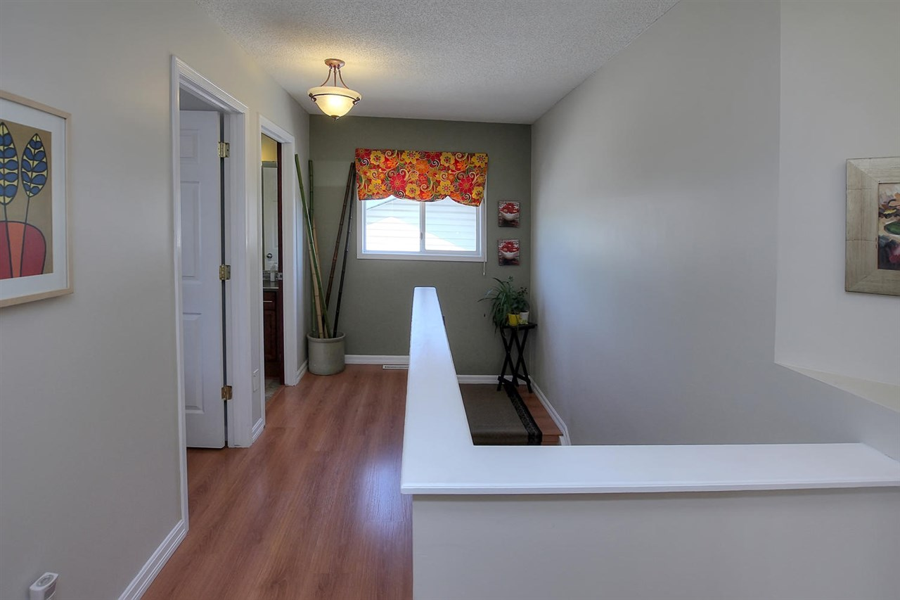 The upper hallway has half walls and also a window that gives you a very comfortable breeze often. It keeps the space light and open .