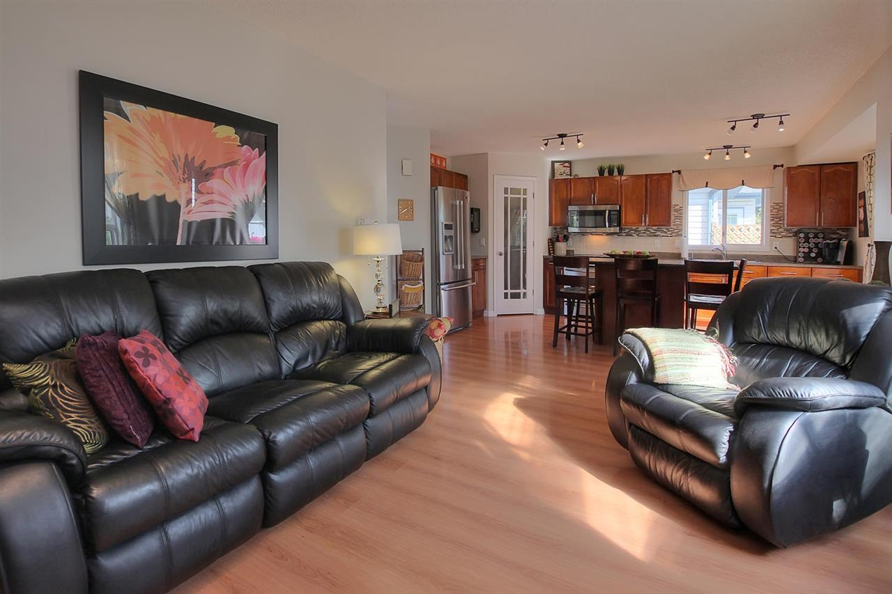 The view from the family room to the kitchen shows the flow and it is easy to handle.