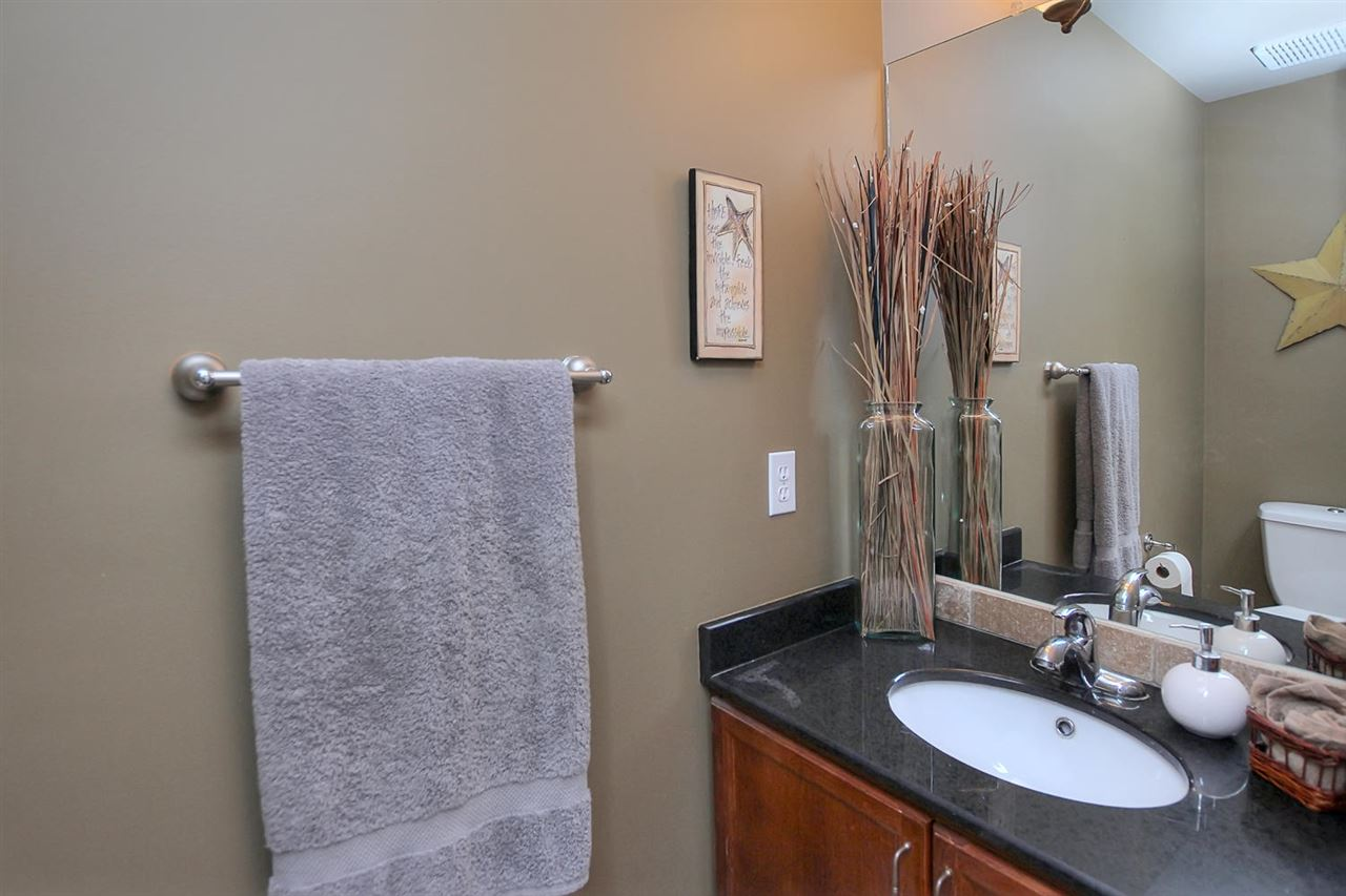 There is a half bathroom at the entrance area from the garage and leading to the basement.