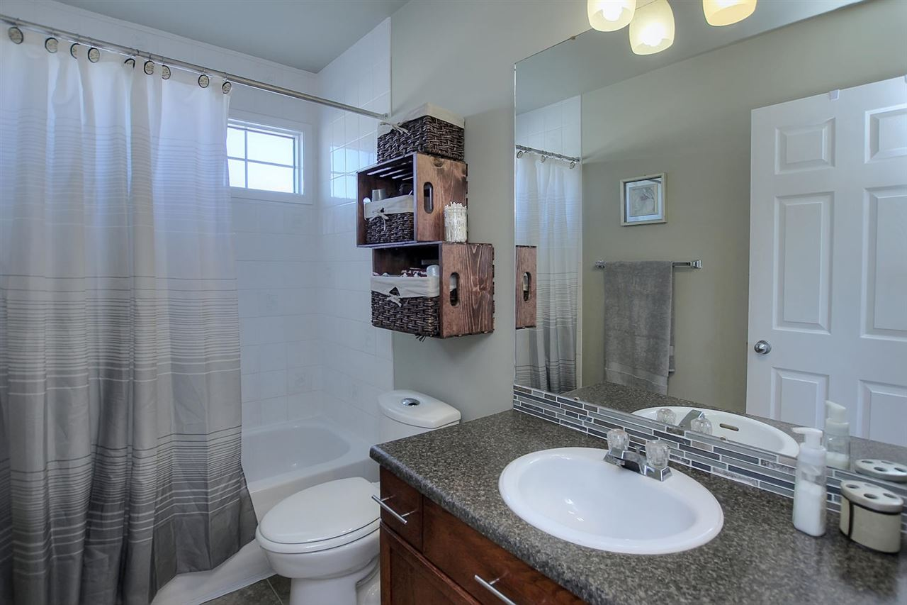 The master bedroom bathroom has a window in the bath to add more natural light and a full tub plus shower.