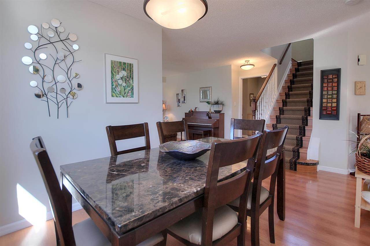 There is indeed a separate dining area where the entire family will fit easily. With the laminate floors, no worries of carrying food over carpeted areas.
