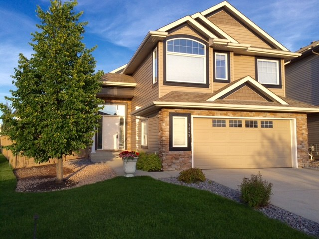 Immaculate over 1,500 square foot Bi-level in South Terwillegar. 3 Bedroom and 3 full bath home in quiet cul-de-sac near walking trails and ponds. Seller will convert DR into 4th bedroom (3rd above grade) if buyer wants. Main & upper have vaulted ceilings. Open concept. Generous cabinetry, large island, corner pantry & S/S appliances in kitchen. Both an eating nook & formal DR. 2 stairways to lower level. Large master suite with generous walk-in closet & stunning ensuite bath that features pillars, corner soaker tub, stand alone shower & well appointed vanity area. Fully finished lower level with huge family room, bedroom, 3-piece bath and utility/laundry/storage room. New raised, no maintenance deck & ground level patio to allow enjoyment of beautifully landscaped backyard. New Central air-conditioning. Lower level has in-floor heating. Garage is heated & insulated and has lots of built-in shelving.