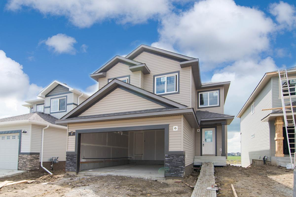 "Welcome to Russieau! The Apparition, built by Look Master Builder, is a gorgeous 2 storey home with 3 bedrooms, 2.5 bathrooms & 2210 sq ft of open concept living space, walkout basement plus a double attached garage! Entering the home, you will notice the 9 ft. ceilings,vinyl plank & tile flooring throughout the main floor. Sandblasted glass double doors lead into the den/home office space.The kitchen features; extended cabinets to 36"" height, plenty of cupboard & counter space, ceramic tile backsplash, & island w/breakfast bar, large walkthrough pantry & a breakfast nook. The living room features an electric fireplace, 2 piece bath & laundry room complete the main level. Contemporary chrome & maple railing leads you upstairs. The master suite features a sitting area w/vaulted ceiling, 5 pce. ensuite; soaker tub & shower stall, & a lge. walk-in closet, 2 good sized bedrooms, bonus room, loft tech area, & 4 pce bath complete the upper level. Ruisseau is a fantastic family neighbourhood close to everything!"