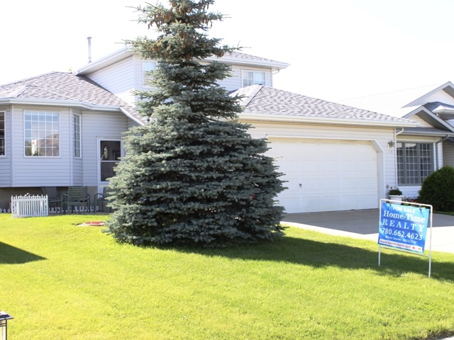 Excellent location for this 4 bedroom 4 level split across from hospital and close to schools in the growing Town of Tofield, just 30 minutes east of Edmonton and Sherwood Park (sun at your back in the am and pm) and 45 minutes from the Edmonton International Airport (YEG).  Bright, spacious kitchen with sliding doors to a raised deck overlooking a beautifully developed yard.  Living room looks out to the Hospital park.  3 bedrooms on top floor (master with ensuite and walk in closet), additional bedroom and bathroom on main along with family room with wood burning fireplace.  New shingles in 2016, new built-in oven in 2016.  Double attached garage.  Tofield offers medical and dental clinics, golf course, numerous other recreational activities and GOOD QUALITY WATER!  Welcome home!