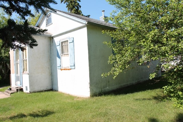 Zoned R 2, great for development.  This 2 bedroom home offers a kitchen, dinette, living room and a porch that can be used for extra storage. There is plenty of room in the back yard for a garden and play area as well as storage for your extra toys. Lot size 50'x135'