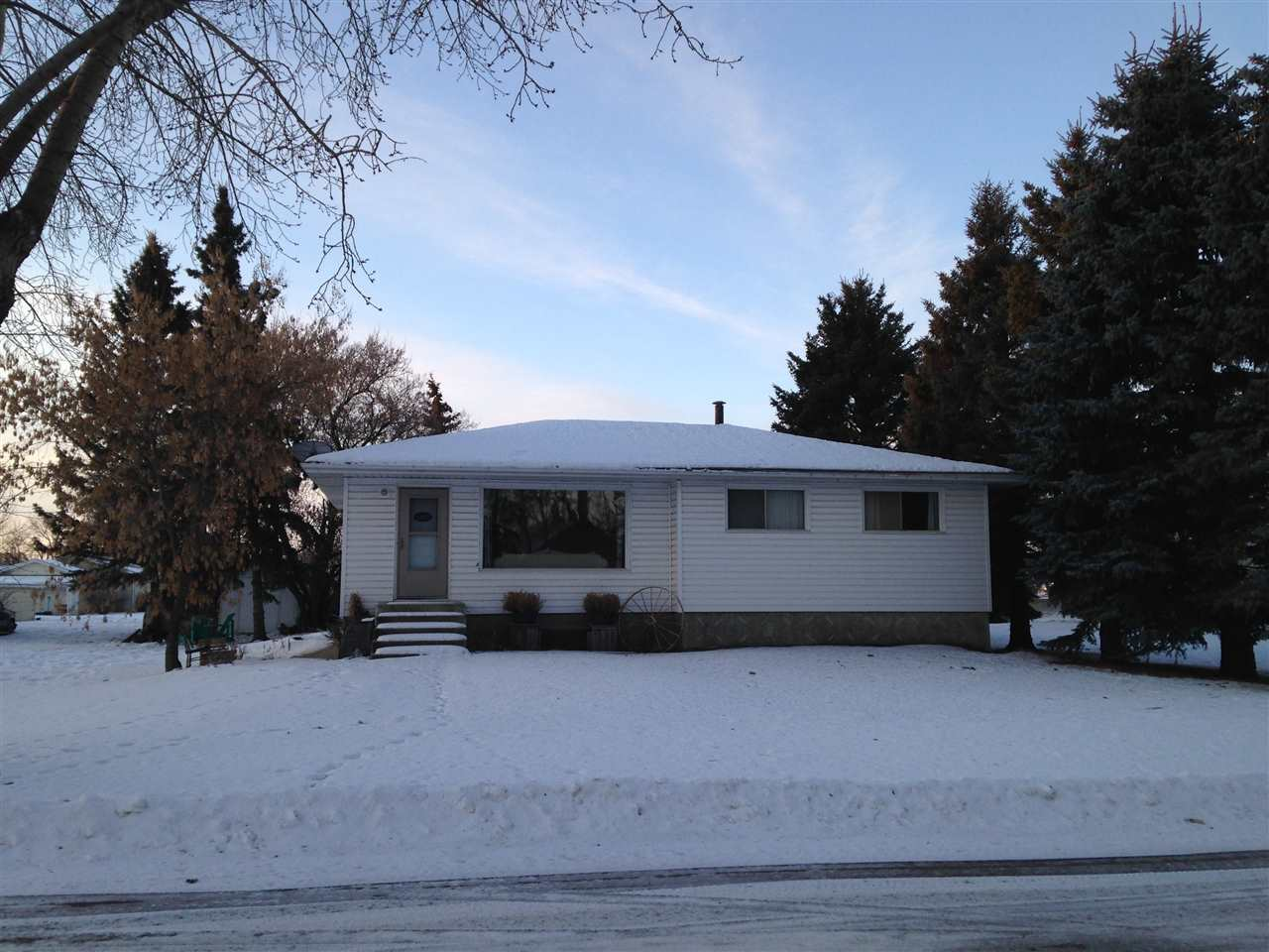 Ready to move in to this 3+1 bedroom, 2 bathroom bungalow on 50 X 140' lot and including the adjacent 50 X 140' lot (separate title). Substantial upgrades including kitchen, flooring, paint, lighting, siding and the fully finished basement with bedroom, bathroom, rumpus room and bar. Plenty of room in the private back yard to build a shop or garage. A great retirement or starter family home with room to grow.