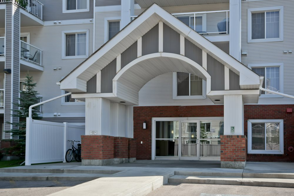 PRICED TO SELL!!!!     2 TITLED PARKING STALLS INCLUDED!!!  Spacious Open Concept TOP FLOOR 2 bedroom 2 bathroom unit in  SKYVIEW LANDING. Kitchen boasts plenty of counter space and a raised GRANITE breakfast bar, large sunny living room and generous dining area. The covered WEST FACING balcony (including gas BBQ hookup) overlooks a green space.   Master bedroom features walk through closet to a 3 piece ensuite. Second bedroom and a 4 piece bathroom. IN-SUITE LAUNDRY and storage. SUPER CLEAN Building includes social and exercise rooms and is PET FRIENDLY. Condo fees include water and sewer.