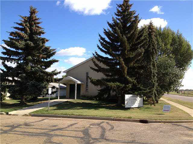 This is a church building which could be a four plex or duplex. some upgrades required. Then lot is serviced by a back alley and has parking in the rear of the building. Oodles. O of parking in the lot across the street. Located very centrally and is within walking distance of the town center.