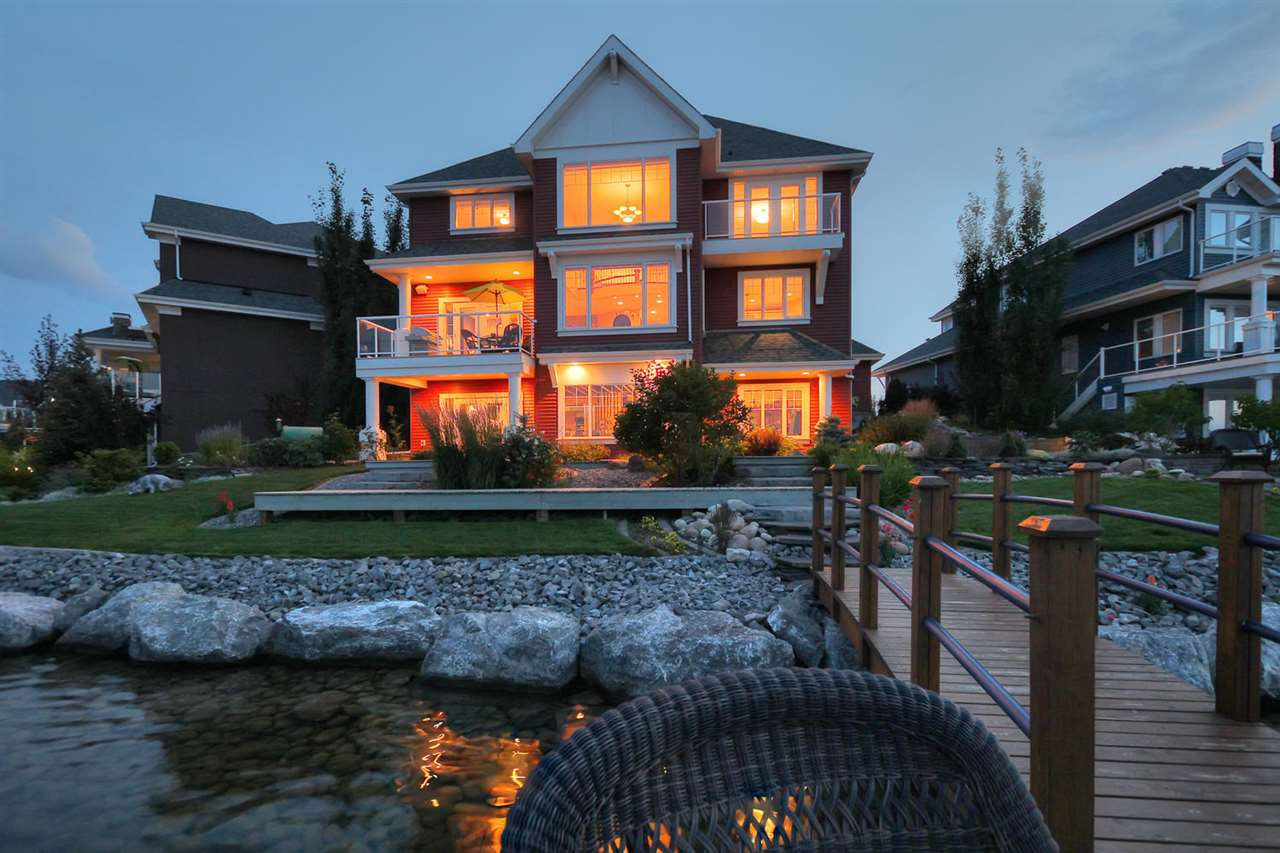 Luxurious 2-storey walk-out BACKING THE LAKE in Summerside! Custom built by Classic Landmarks Master Builder, this beautiful 2948sq.ft. home boasts an abundance of natural light, cathedral ceiling & panoramic lake views. Spacious & open, the main floor features a gourmet kitchen w/ hearth-style built-in cooktop, oversized island & breakfast nook overlooking the lake. A stunning stone arch feature wall separates the main floor family room w/ fireplace & living room w/ East facing balcony, while the sweeping staircase ascends you to 3 bedrooms, incl the master w/ private lake view balcony & ensuite w/ jetted tub. Professionally landscaped, the spectacular yard boasts a pond w/ exquisite waterfall, and private & personal dock. Addt?l features incl a main floor bedroom, unfinished walk-out lower level, Brazilian cherry hardwood floors throughout & much more! From canoeing & fishing in the summer, to skating & hockey in the winter, you?re sure to enjoy the year-round living that Lake Summerside has to offer!