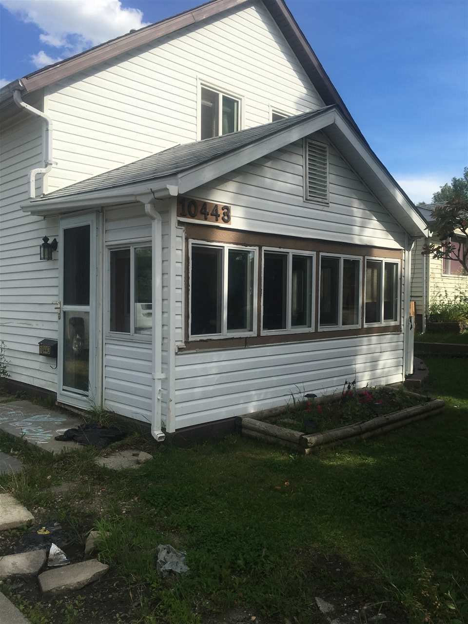Huge 50x150 corner lot with new double garage, perfect for redevelopment (property next door same size also for sale)! The 2 story home comes with 3 bedrooms and has all new windows, newer kitchen cabinets, flooring, insulation upgrades, plumping upgrades, 100 amp electrical, high efficiency furnace and a large sun room. Awesome location close to schools, shopping and transportation. Live in or rent, re-develop in future! Appliances neg.