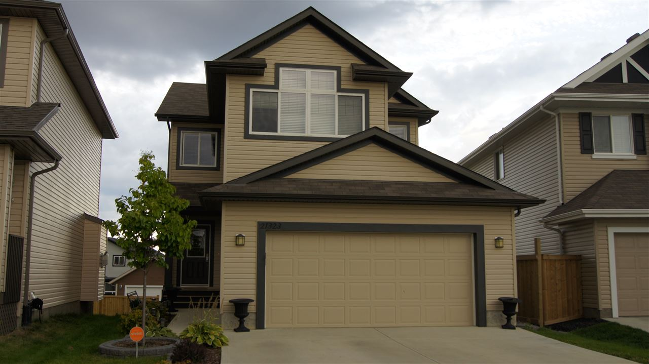 Welcome home to this 2 storey walk-out in a cul-de-sac location. Built by Look Homes in 2012, the main floor greets you with 9ft ceilings, open kitchen/living room design, main floor laundry, 2 pc bathroom, heated attached 2 car garage and air conditioning throughout the house. Open up the chef in you with the kitchen which has espresso coloured cabinets with modern tiled backsplash, granite countertops & island and is finished with stainless steel appliances. Dining room walks out onto the deck where you can enjoy the morning sunrise and cuddle up to the evening in front of the fireplace in the living room. 4 generous size bedrooms are on the upper floor with a master that has a 4pc ensuite and walk-in closet. Addition to the upper level is a bonus room with vaulted ceilings where you can enjoy movie night with the family. Wait...to finish this awesome home is the walk out basement to a large yard and back lane access for RV parking. A bonus to the location is watching the kids walk to school!