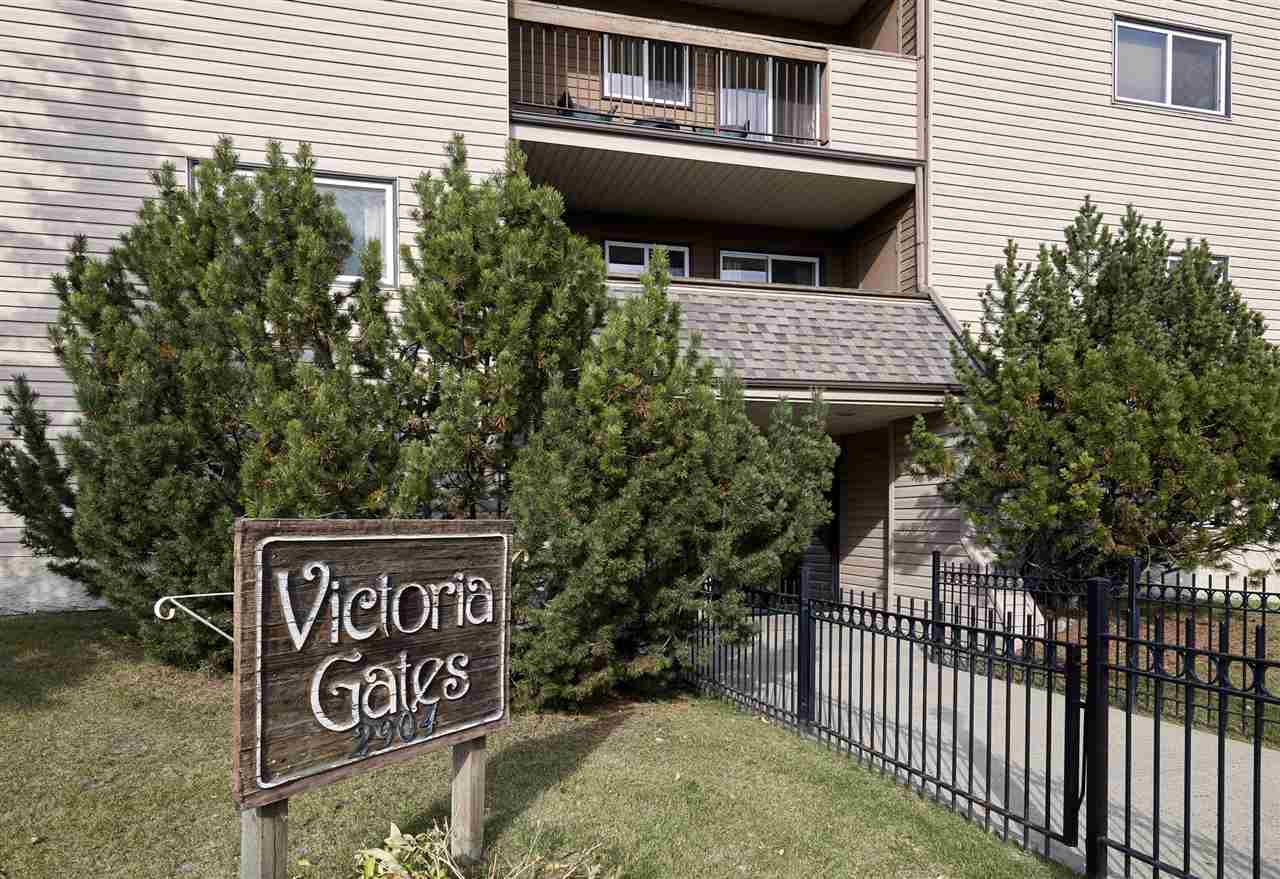 Welcome to Victoria Gates an immaculate 18+ building situated in Hairsine. This 980sqft - 2 bedroom, 2 bathroom unit is located on the 2nd floor offering a south facing view of tress from the large balcony which also offers a large storage room. Entering the condo you will love the natural light flowing throughout.  Step into spacious kitchen open to the large dining area and on in to the large living room with wood burning fireplace. Continue on down the hallway and you will see the large laundry room with full sized washer and dryer and more storage!  The large master bedroom is bright and fully of light, a walk through master close leads you to the 2 piece ensuite bathroom.  The 2nd bedroom is a good size, a 4 piece bathroom completes this amazing condo!  This condo is perfect for an older family, empty nesters; what more can you ask for in a building that offers an exercise room and sauna, just steps to a bus route, close to all amenities and a short bus ride from Clareview LRT station!