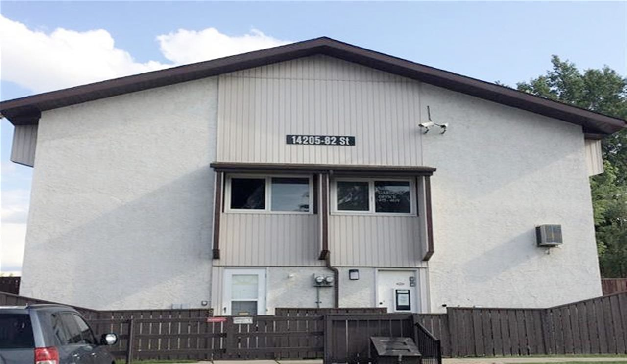 ip mall, schools & all amenities. Main floor features Living room with bright Windows. Kitchen with Appliances & Dining area. Upper floor offers 2 Good-sized Bedrooms & a Full Bathroom. Recent upgrades: Newer Hot Water Tank, Furnace (2006), Newer Windows, Shingles, Laminate floorings. Fenced yard and one energized Parking stall right in front of the Unit. First time Home Buyer & Investor, DON'T miss out this Low Affordable home!