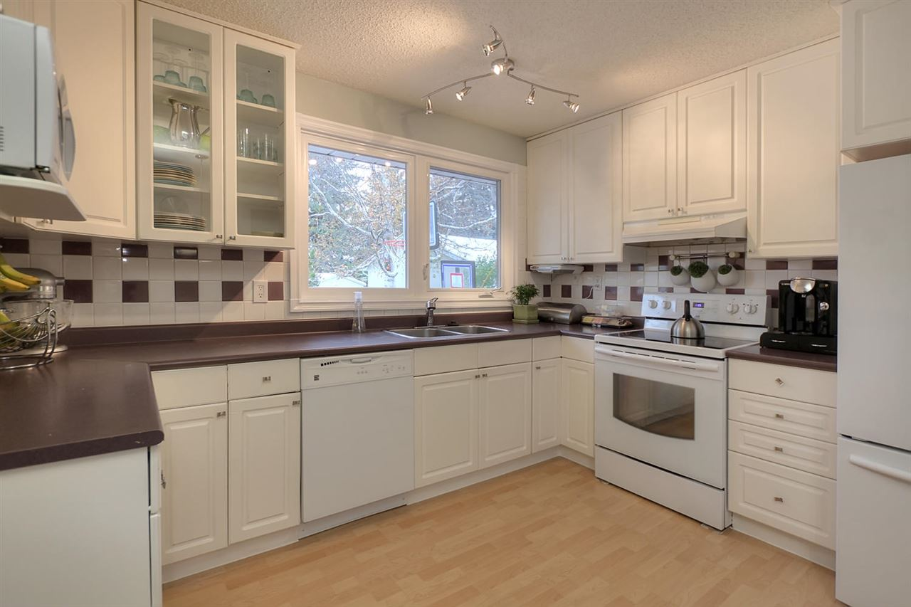 This newer white kitchen is well planned and the window allows you to watch the kids playing in the back yard.