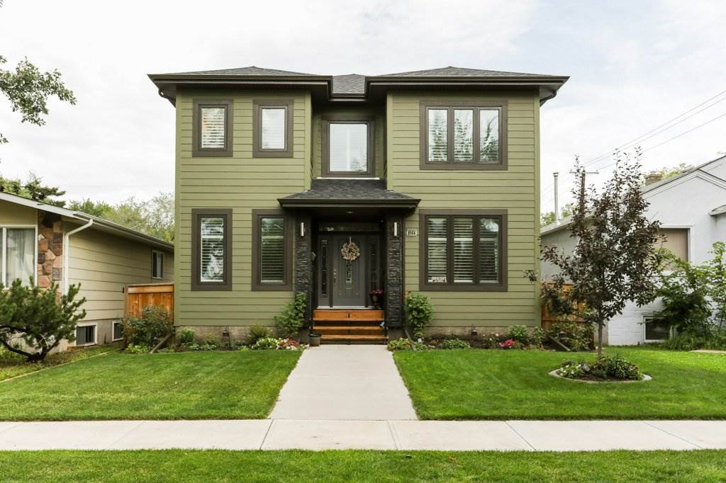 King Edward Park is a quite family area surrounded with access to the popular path systems to the river valley, University and Whyte Avenue. This impressive 2 storey home is a perfect combination of modern and traditional with an excellent floor plan. 5 bedrms in total with gorgeous hardwood, granite counter tops and top quality finishing throughout. The main floor offers a professional dining rm, den, family rm, laundry rm, 2 pce bathrm and a jaw dropping kitchen. It truly is the heart of the home with earthy neutrals, gleaming granite, high end appliances that include a stove top and oven. The upper level features an enormous master bedroom with a luxurious marble ensuite and a walk in closet with built in shelving. The other 2 bedrooms on the upper level are large and are close proximity to the 4 pce family bathrm. The lower level is over 1086 sqft. and is fully developed with 9 ft. ceilings 2 more large bedrooms and another 4 pce. bathrm. The backyard is fenced with a deck and a dbl detached garage.