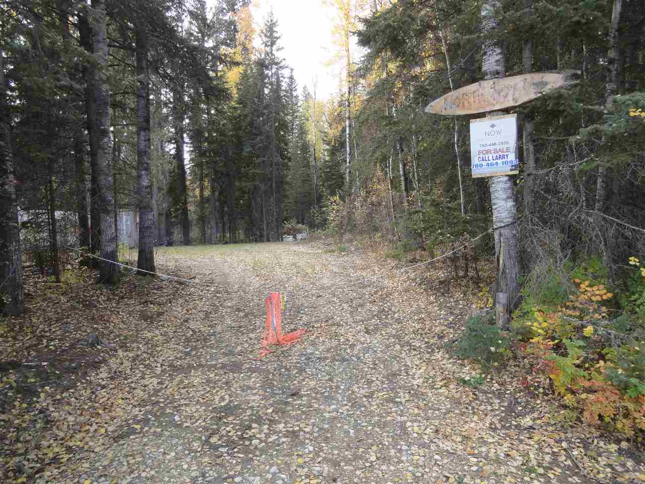 QUADING, HUNTING & FISHING.  1.91 acre mostly treed site (some trees as high as 90 ft.) except cleared building site where two older holiday trailers sit next to 40 x 8 ft. sea can.  Site is adjacent to thousands of miles of scenic trails on Crown land. 3 months hunting season. Owner yearly catch 14 lb. pike.  This site is located across the road from the lake. MD of Opportunity will provide for free water and sewer services to the site if new owner builds an approved home.  Important: Sea Can can't remain on site unless owner builds a permanent resident prior to June 2018.  All paved roads to Sandy Lake, which is 3 hr. drive N of Edmonton. Sandy Lake has 120 lots with approx. 45 homes. NOTE: Listing Realtor is one of the owners.