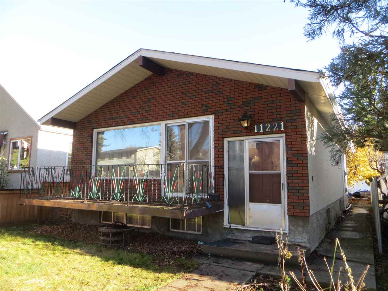 One block from Ada Blvd and the River valley!  Put some upgrades into this diamond in the rough. Expensive items have already been done like the 2 high efficient furnaces and hot water tank.  There is a separate entrance with roughed in plumbing in the unspoiled basement, so there could be suite potential with the separate furnaces as well.  This 1110 sq ft home was built in 1972 and has an open beam vaulted ceiling in the living room.  2 bedrooms upstairs plus 1.5 bathrooms.  The windows in the home maximize the natural light in this home.  There is also a double garage, but it does need work.  Prime location with other infill homes on the block.