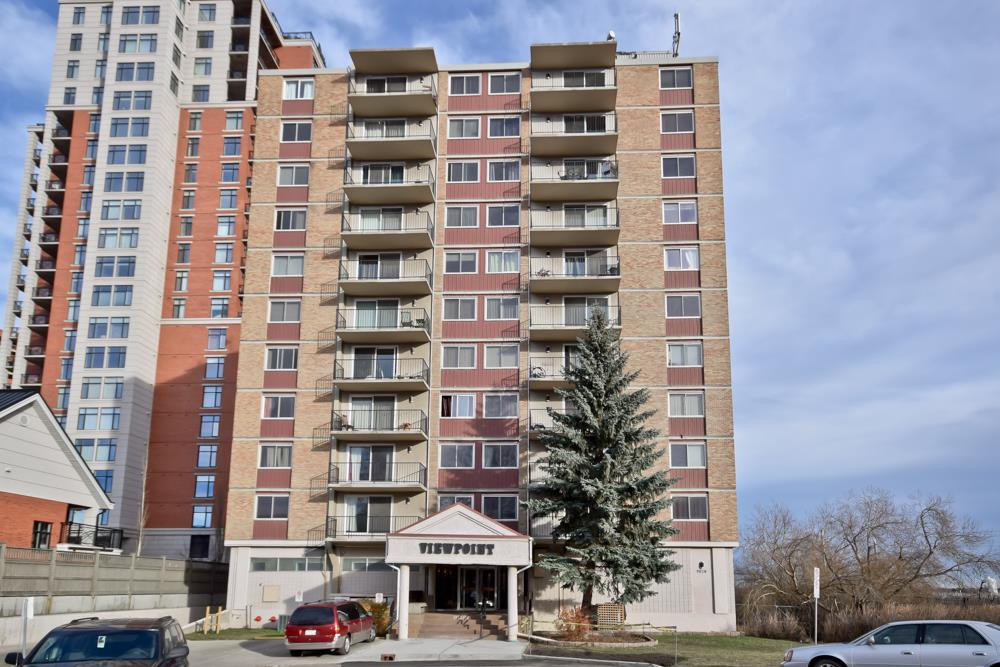 ATTENTION ALL 1st TIME BUYERS AND INVESTORS!! Concrete building.   Huge Value! .......Located adjacent to the New Quarters Developments..... Upgraded 10th floor corner unit 2-bedroom, 4 piece bath, new Walnut laminate flooring, newer carpet, upgraded newer white kitchen and appliances. Views to River Valley and Downtown. Underground heated parking. Walkable location, steps to River Valley Trails and minutes to downtown. CONDO FEES INCLUDE ELECTRICITY,WATER AND HEAT