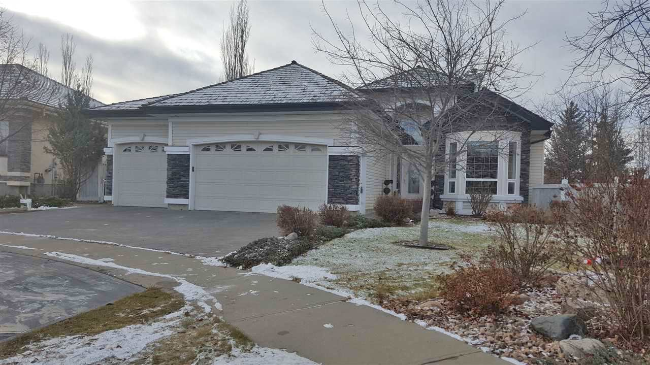 Gorgeous custom built adult walk out bungalow sitting on a huge pie lot, mature trees, firepit, water fall and backs onto green space.  This home has so many features and upgrades.  Very open main floor with raised 10 and 12 foot ceilings, great room concept, huge island kitchen, walk thru pantry, large eating area over looking back yard.  The master suite is very nice with large walk in closet and 5 piece ensuite.  The lower level is professionally developed with 2 bedrooms, office, rec room and family room - plus a huge storage room.  This home is  non smoking and no pets.  Home features central air conditioning, underground sprinkler system, alarm, triple attached heated garage plus so much more.  Show and sell with confidence.