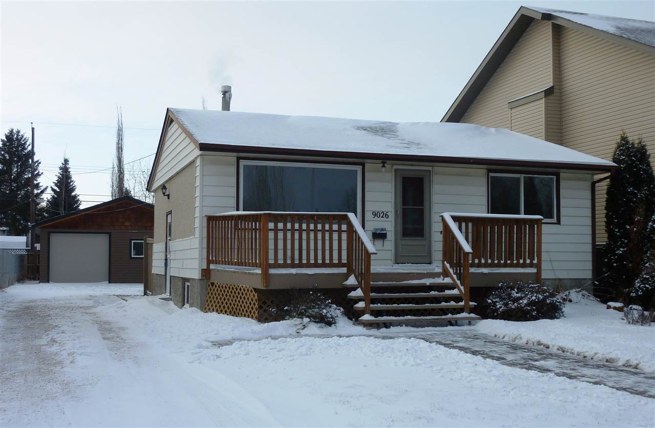 """Jasper Park Bungalow. Cozy 800 Sq.Ft  2 + 1  Bedroom  1 Bathroom. Mechanics / Hobbyist  Dream Garage Workshop 30 ' x 26 ' Complete w/ Double Doors  to the Rear/Alley Single Door to the Front.Practical Kitchen. Oak Cabinetry, Tile Back-Splash. New Shingles on House this Year(2016) Original Hardwood on Main plus some just completed Laminate """" Plank""""  Flooring. Painting/ Decorating  Fixtures, Casings all New. Basement Finished just requiring  Flooring in the Family Area to complete.Front Veranda/ Deck affords some Character to the Curb. Full 5 Appliance Package. West Yard Feature of the 50' x 148' Lot. With Several In- Fill Properties Nearby.Schools,Shopping,Hospital,Medical,Library All  Services.Terrific Commuting to the Whitemud/ Yellowhead/Anthony Henday. Immediate.Drive By Check out the Little Value Gem @ 9026 -150 St."""