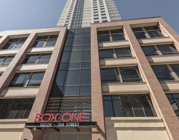 Be inspired with the gorgeous views of Downtown Towers, the 104 Street Brick Buildings,  Rogers/Ice District, the greenery of boulevard trees and peeks of the valley. This 2 bedroom and 2 bath offers plenty of room in the smartly designed open floor plan and features contemporary décor, granite, kitchen island, large pantry, full back splash, SS appliances, in-suite laundry, one underground parking stall and a large balcony with gas hook-up. Large windows in every room guarantee lots of natural light through-out. Unsurpassed location an Urban Village; dining, shops and cafes, the Business/Financial Hub, Ice District, Theater, Arts, Fitness, Shopping, Transportation, River Valley, Macewan all within walking distance + LRT connects you in minutes to the U of A, Southgate and Nait. Evenings on 104th street are magical with unsurpassed ambience where the night sparkles with lit trees.