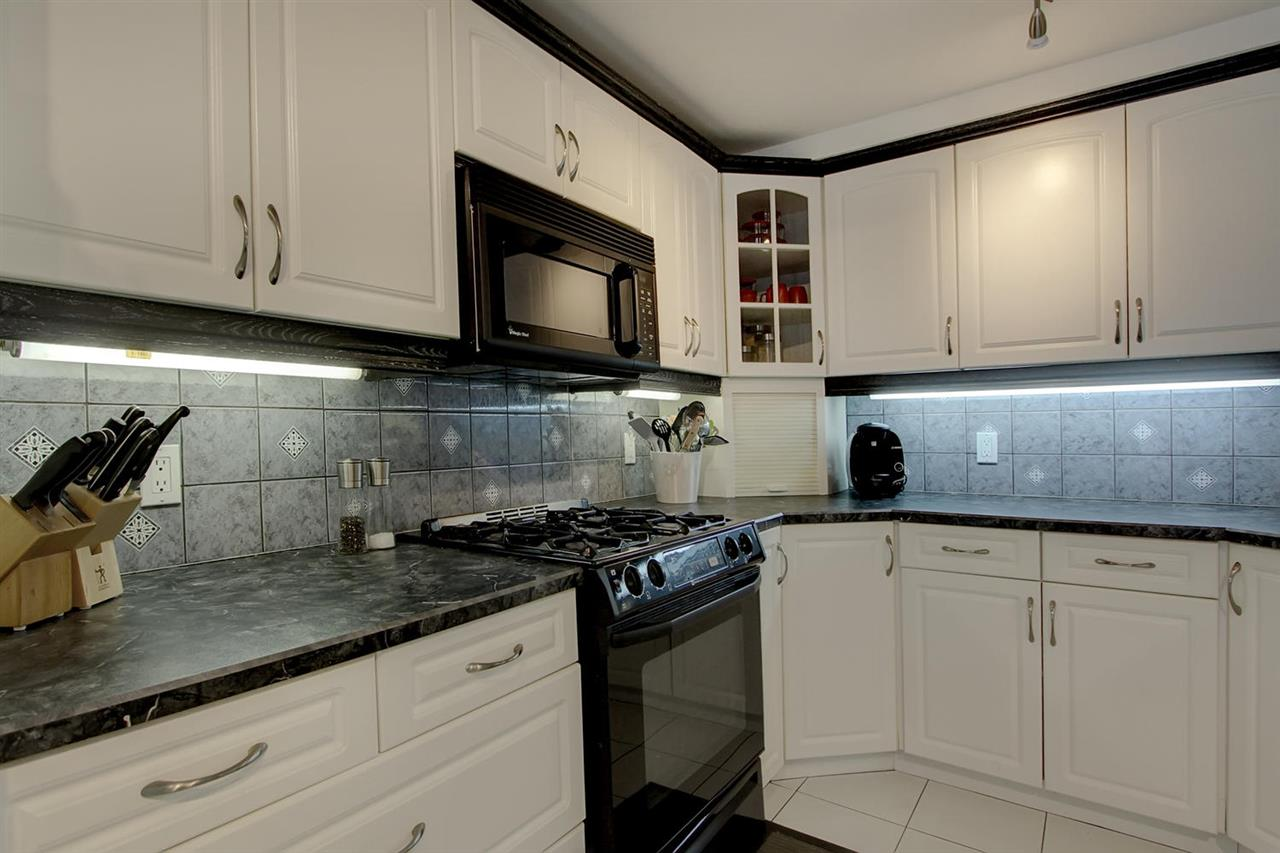 Note all the extras you will find here. From the under cabinet lighting, the gas range with otr microwave, appliance garage, back splash and more.. you will be thrilled to have moved up to this gourmet kitchen.