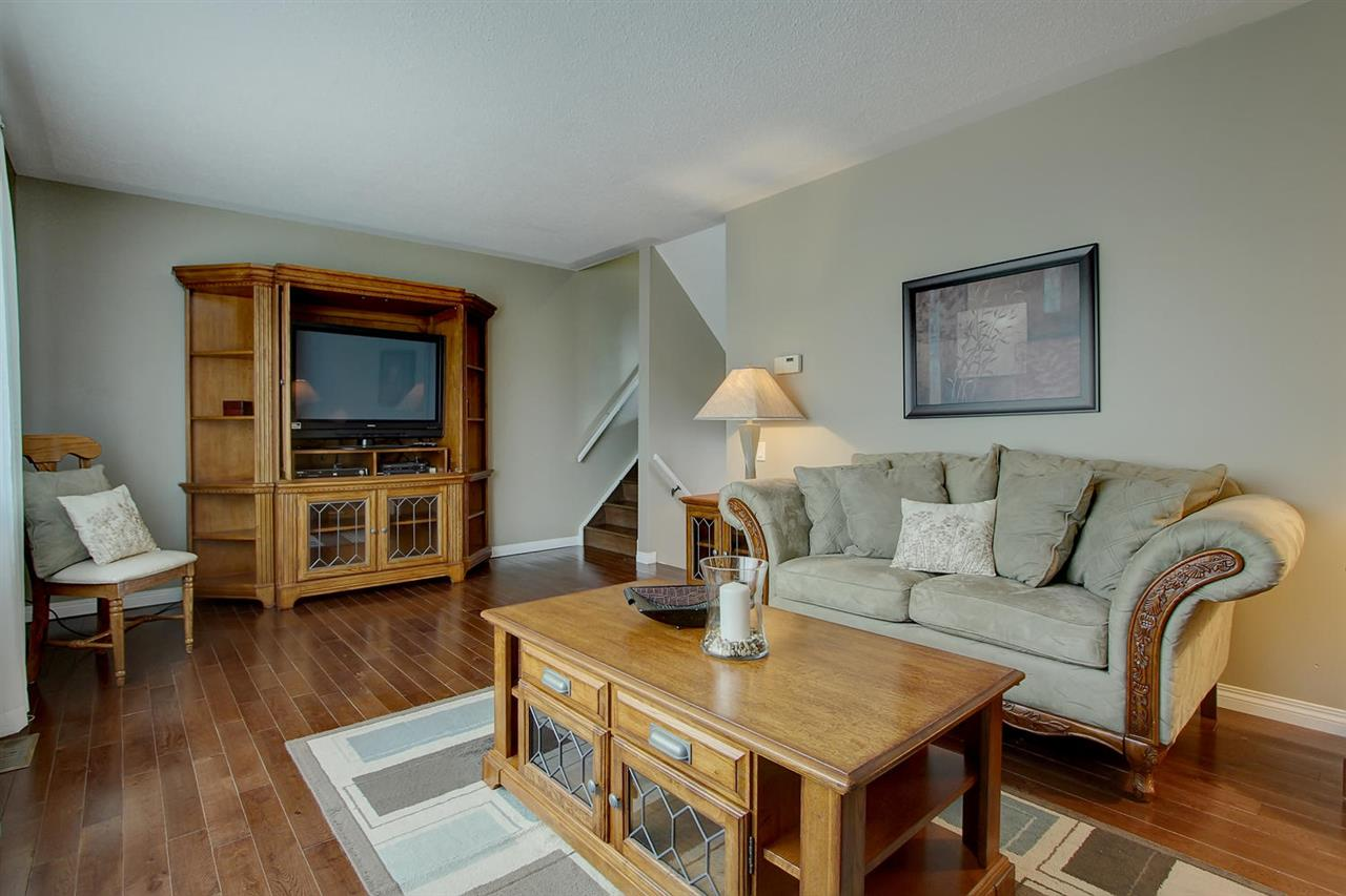 Most living rooms don't have the space this one does. The large newer windows make the room bright and highlight the luxury of real hardwood flooring.