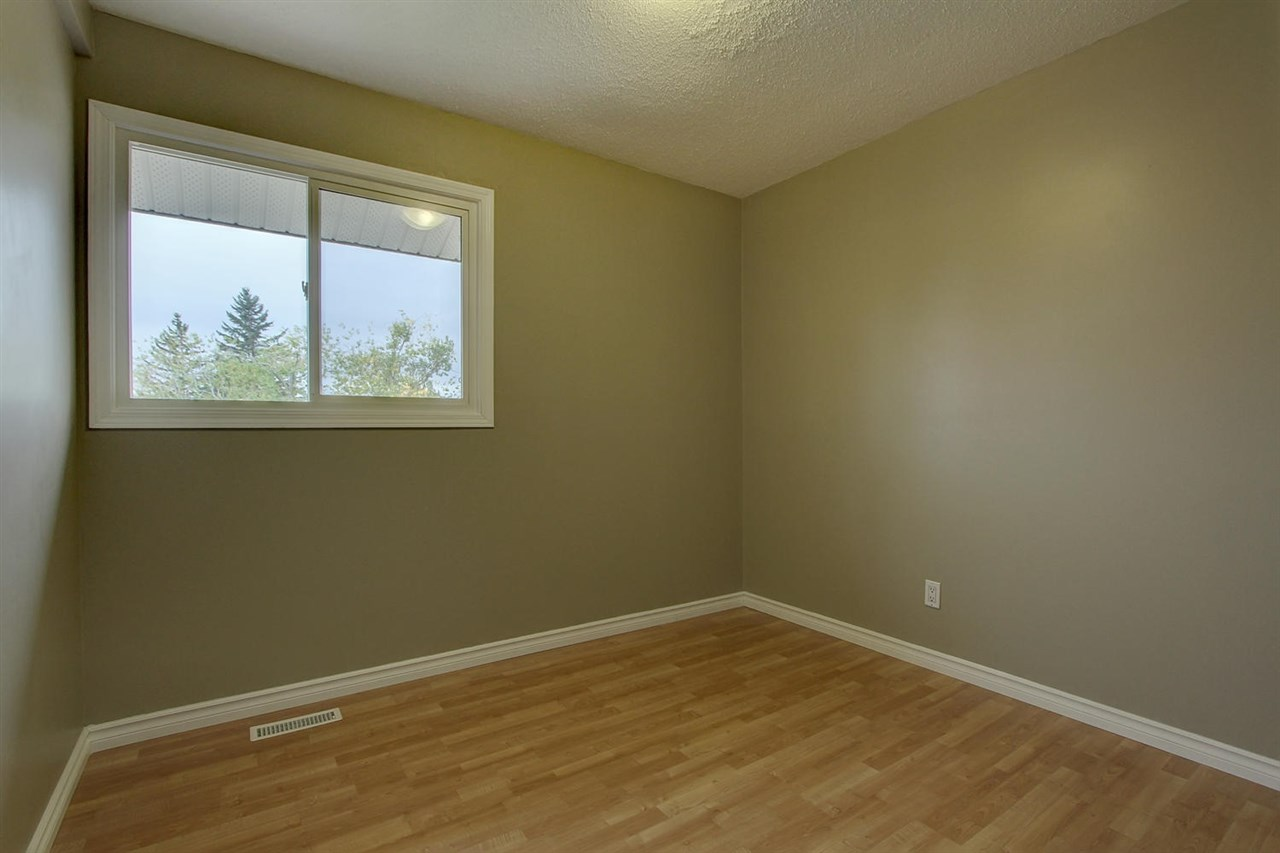 The two bedrooms on the upper most level both have new paint, new laminate flooring and also the new windows that were installed throughout the condo.