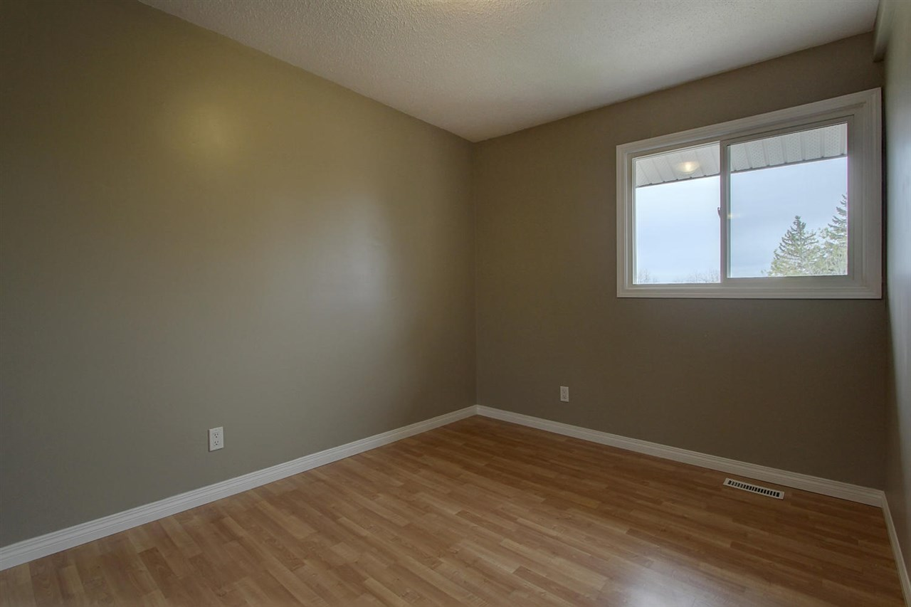 This is the other of the two bedrooms on the upper level. The closets space is the only difference between the two. Otherwise, new paint, new window, new laminate flooring and even baseboards.