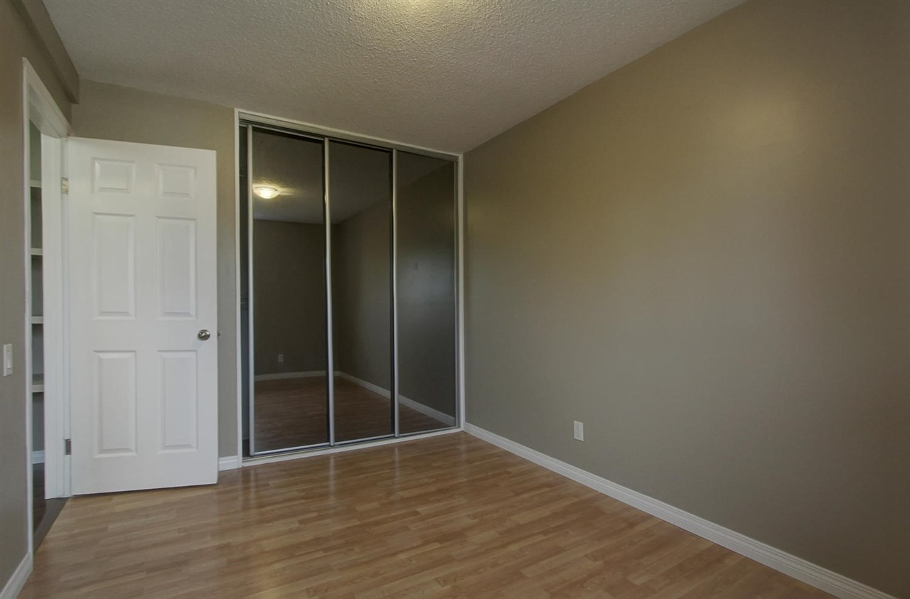 One of the two upper bedrooms has a large closet that has organizers inside. The mirror doors make the room appear larger.