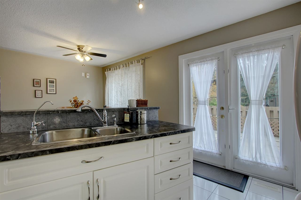 The design of the new kitchen has so much to offer. It is open to the dining room. The french doors open to the low maintenance fenced backyard. The central vac unit is in the back area also.