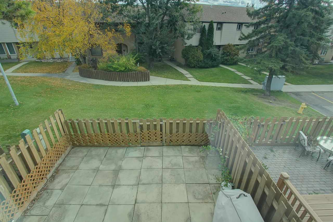 The view of the backyard from the upper master bedroom window again shows the green space behind. You are permitted to have a dog in this complex. Ask permission first.