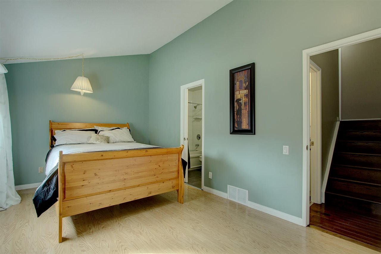 Another view of the master bedroom which has laminate flooring.