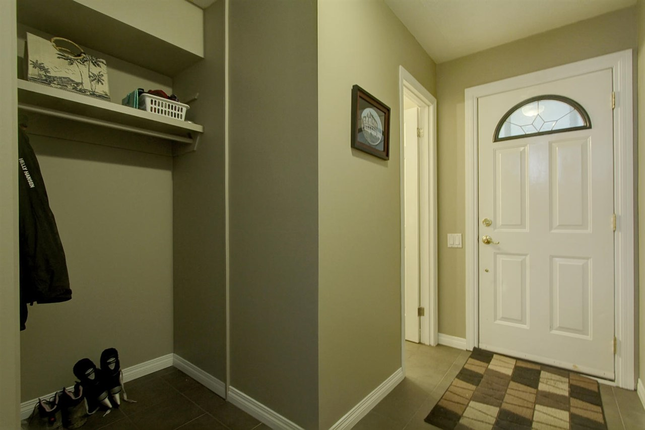 The handy entrance way has a powder room. Space to hang your coats and you can either go down to the basement or up to the living/kitchen level.