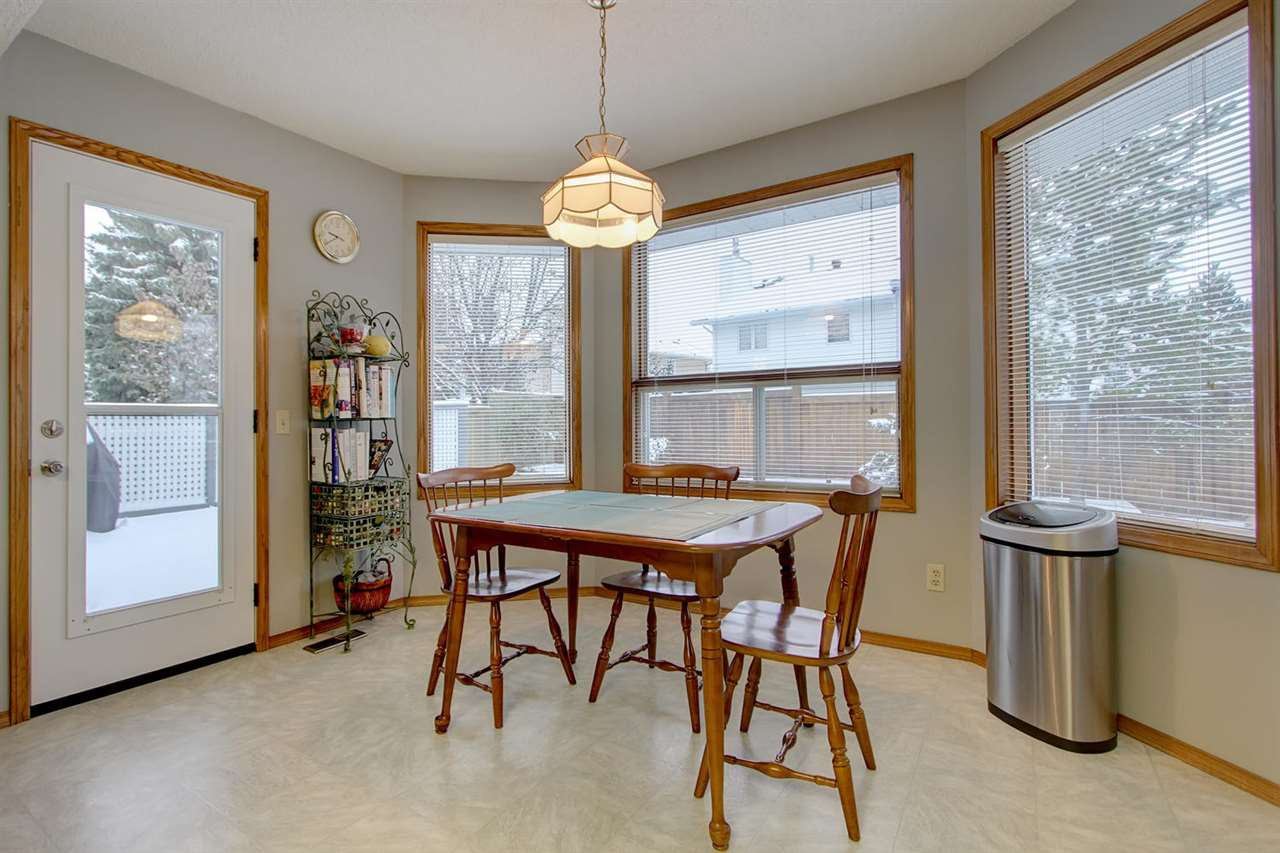 The eat in kitchen space is also very generous and meals here will be a treat with a great view of the back yard. The door to the left opens onto the huge back deck.