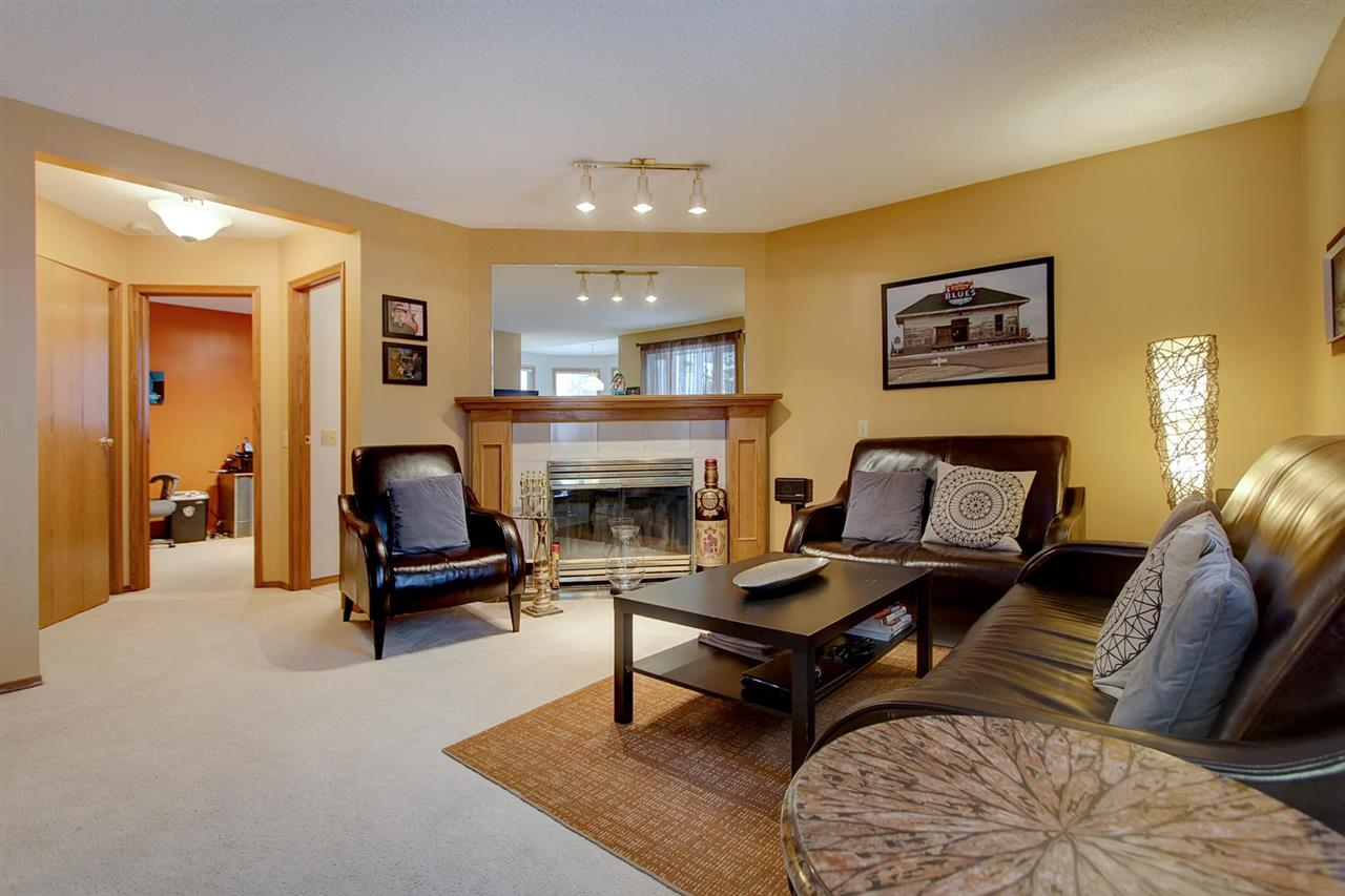 From the entrance way to the kitchen, this is the view of the family close by having a great time in the family room.