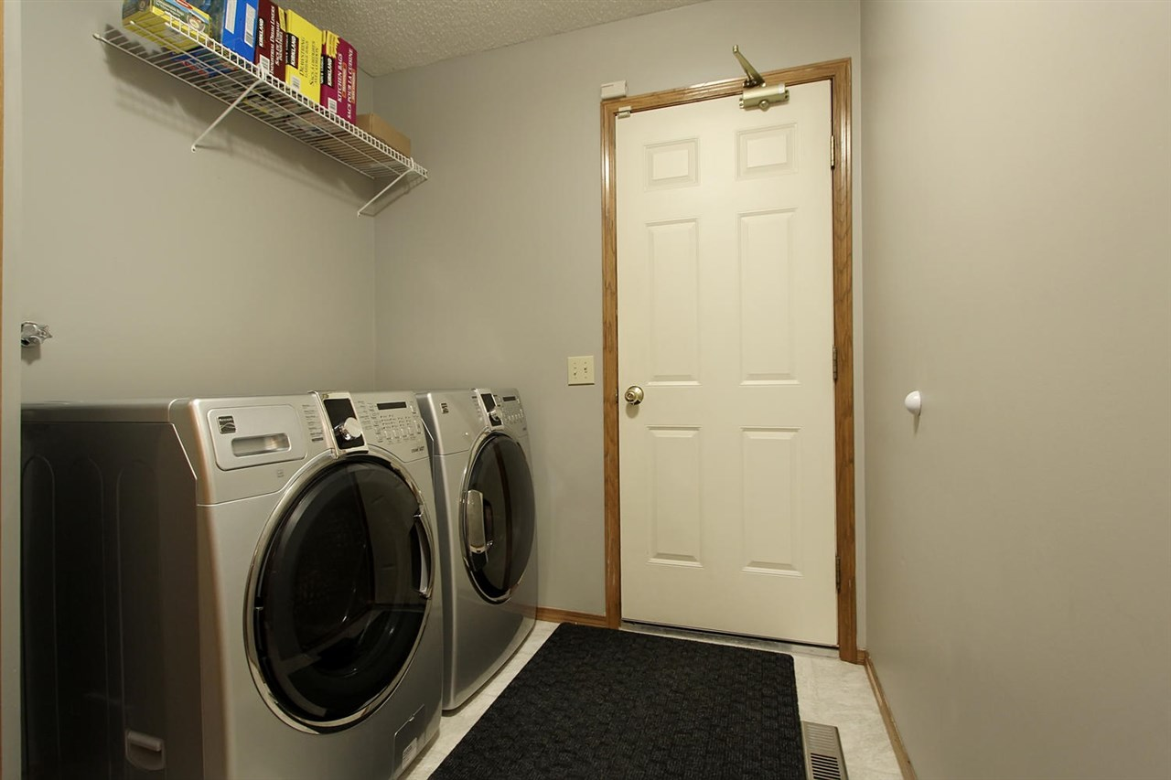 A large laundry area leading into the garage is well placed. There is another walk in closet in this space to organize additional cleaning items and to hang items to dry.