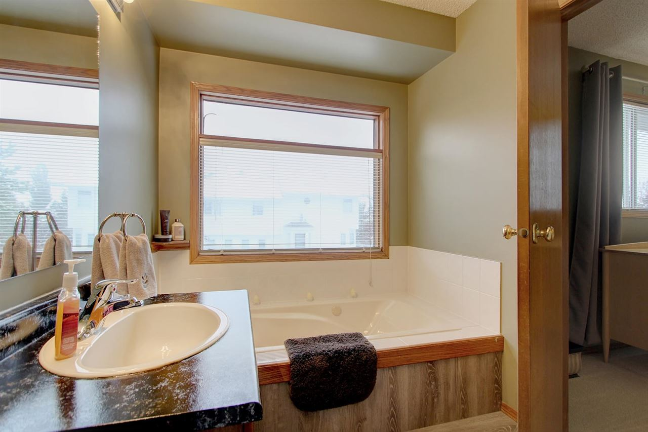 The en suite bathroom has a Jacuzzi tub, large window, separate shower and good sized vanity.