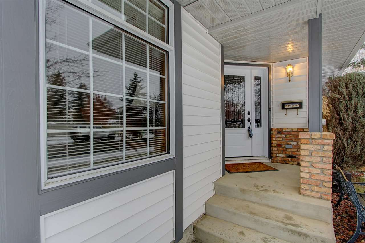 The front door is on a nice sheltered porch. Note the front door has a side light that opens for easy furniture moving. (or handicap access)
