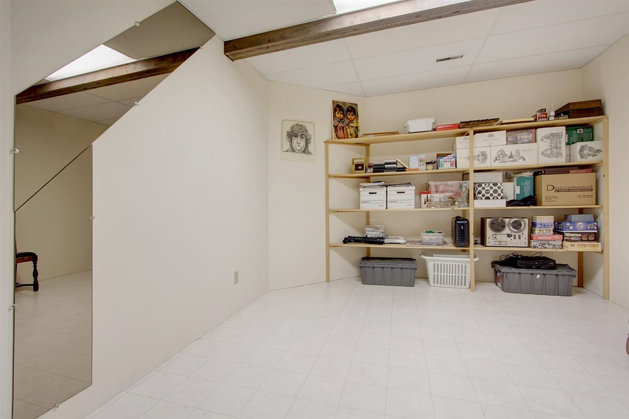 This room in the basement is used for storage. It has a door and a large closet. If you installed a window on the right wall, it would make one more perfect bedroom. With the vinyl flooring, it is also a nice hobby or sewing room.