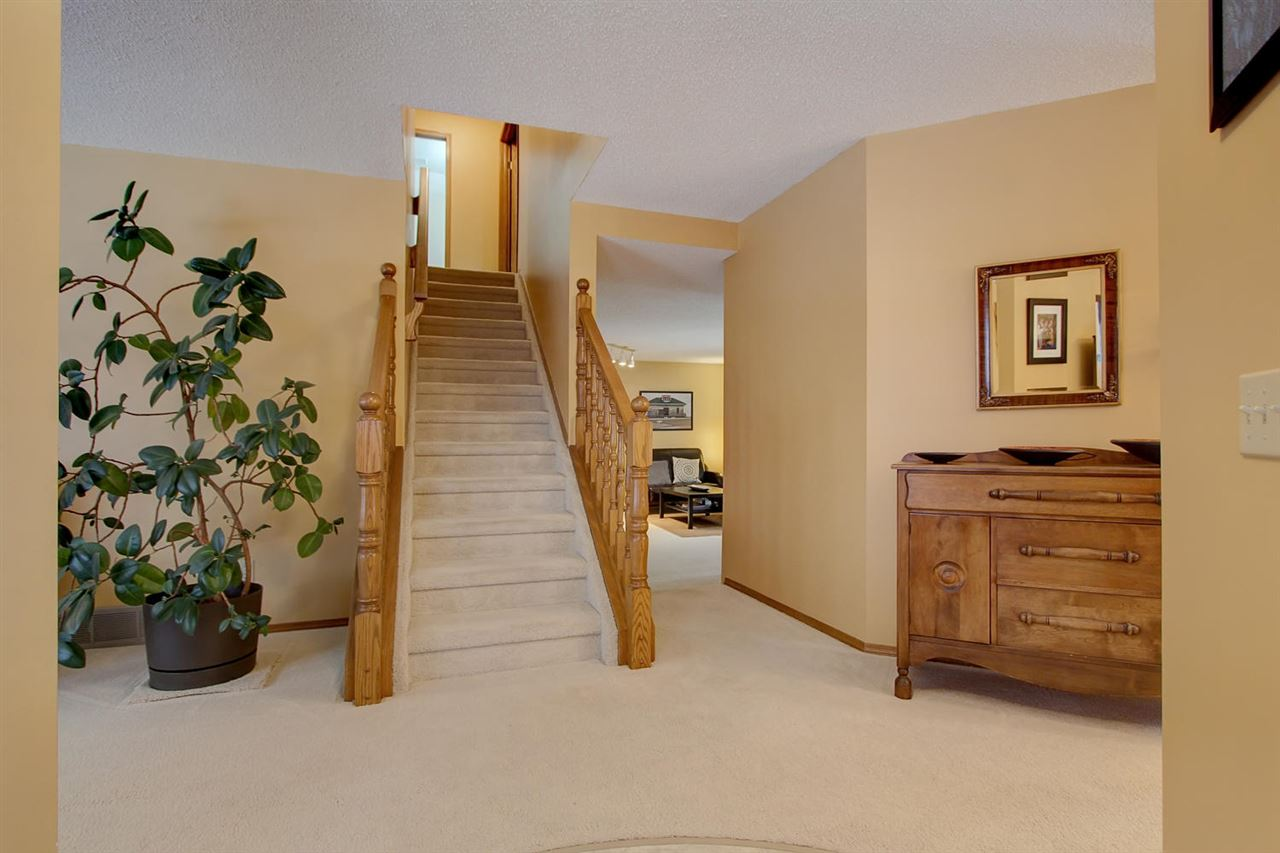 The inside area opens to the living room to the left.. the stairwell ahead of you and the hallway to the family room.