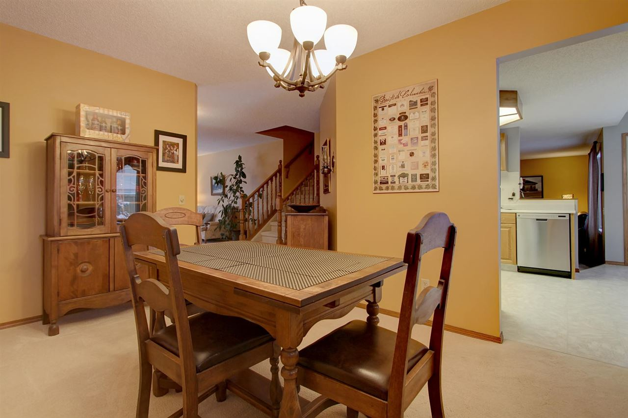 This view of the dining room shows that the room does open into the kitchen for convenience of serving and cleaning up but there is sense of privacy you will enjoy during your meals.