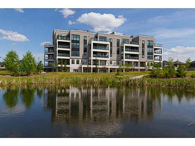 Experience luxury living at Windermere Mansions nestled in the exclusive & walkable neighbourhood of Upper Windermere! This contemporary 1342 sq ft condo offers beautiful details & upgrades, 2 spacious bedrooms, 2 full lavatories & gorgeous views. Enjoy a spectacular kitchen that boasts a generous granite island with wine rack, ss appliances including commercial grade gas stove, glass tile backsplash & contemporary style kitchen cabinets with soft closers. The dining & living space feature large windows that capture sunny vistas with access to a spacious, covered balcony offering nature & lake views. The sizeable master offers a large WIC & impressive spa ensuite with soaker tub, rain shower & double sinks. Discover upgraded lighting, custom closet organizers, 9 ft ceilings, porcelain tile & engineered hardwood flooring throughout. Concrete & steel building, a/c, 2 titled, underground parking stalls, & much more! Luxury lives here!