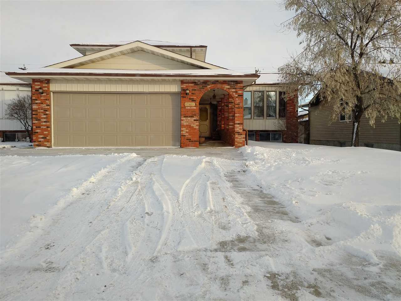 Opportunity is calling with this large home with good bones needing upgrading. This home has 3 bedrooms up with master bedroom en-suite and walk in closet, there is an additional 2 bedrooms and 4 piece bathroom. The main area has a large den with a closet so it may be used as an additional bedroom, a living room, dining room, large eat in kitchen, a family room with wood burning fireplace and patio doors to the back yard, a two piece bathroom, laundry room and access to the double insulated and dry-walled garage. The 4th level has been dry-walled and requires flooring and ceiling and offers a large family/rec room. The 5th level has another wood burning fireplace, storage rooms, roughed in plumbing and laundry. The shingles are about 5 years old. This diamond in the rough is nestled among larger homes in an older established community with quick access to the Yellowhead and Anthony Henday. Great opportunity for those needing a large home as with a little elbow grease this home will sparkle.