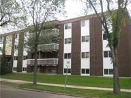 PRICED TO SELL. 1 Bedroom Top Floor Corner Unit in Sundial Manor in UPSCALE WESTMOUNT District. UPGRADED with new laminate and tile flooring, vinyl windows, new paint baseboards bathroom tub surround in ceramic tile. All renovations by licensed trades. Balcony Doors Scheduled for Replacement by Condo project. WEST FACING BALCONY makes Unit bright and cheery. FENCED PARKING LOT with 1 stall dedicated to Unit 408. Secure Building with superior condition throughout. Newly painted common area interior by professional Property Manager. Condo Fee includes Utilities: Heat and Water. Walk to 124 Street Art Gallery and Restaurant District. Excellent access to public transportation and bike routes. Approx. 5 minutes to new Arena and downtown business district. Lots of new shopping under construction at old Molson Brewery site.